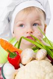 Boy with vegetables Stock Photography