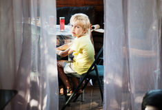 Boy on the veranda Royalty Free Stock Photos