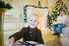 Boy is very happy and shows your Christmas gift Stock Photos