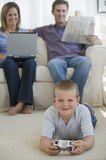 Boy with video game Royalty Free Stock Photo
