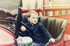 Boy in a Vintage Fire Truck - Retro Royalty Free Stock Images