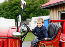 Boy in a Vintage Fire Truck Smiling Stock Image