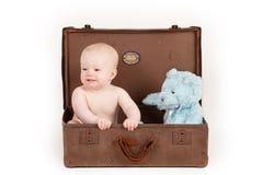 Boy in Vintage Suitcase Stock Photos