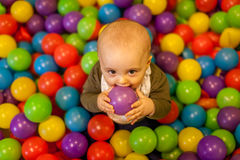 Boy with violet ball Royalty Free Stock Images