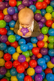 Boy with violet ball Stock Image
