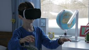 Boy in virtual reality glasses playing 360 degree game - 4k stock video