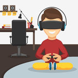 Boy in virtual reality glasses. Teenager boy with game controller gamepad in virtual reality glasses and headphones on the background of the workplace. Playing Stock Image