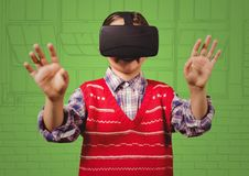 Boy in virtual reality headset against green hand drawn windows Stock Photos