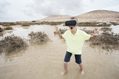 Boy in virtual world with virtual glasses Stock Photo
