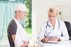 Boy visiting doctor after accident Royalty Free Stock Image