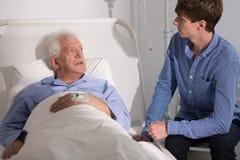 Boy visiting his grandpa Stock Image
