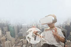 Boy in VR headset touching planet against city background. Digital composite of Boy in VR headset touching planet against city background royalty free stock images