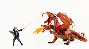 Boy vs. dragon Stock Images