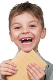 Boy with a waffle. Portrait of a cute boy having a waffle - isolated on white royalty free stock photos
