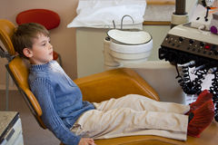 Boy wait medical worker in stomatological office. Young boy wait medical worker in armchair stomatological office Stock Photo