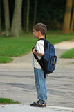 Boy Waiting on Bus. Boy at bus stop waiting on bus Stock Photo