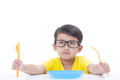 Boy waiting for food Royalty Free Stock Photography