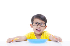 Boy waiting for food Stock Images