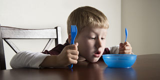 Boy waiting for food royalty free stock photo