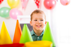 Boy waiting for friends to come to the birthday party stock photography