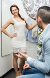 Boy waiting for girl trying on clothes Royalty Free Stock Photo