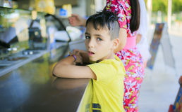 Boy waiting his ice cream Stock Images