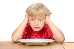 Boy waiting for his meal Royalty Free Stock Images