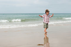 A boy waiting ride on a beach Stock Image