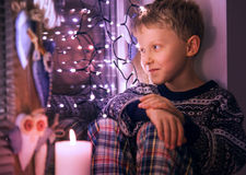 Boy waiting for Santa   Royalty Free Stock Photography