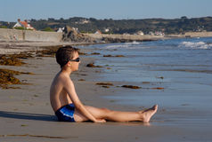 Boy Waiting for the Tide Stock Image