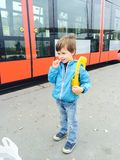 Boy waiting the tram Stock Image