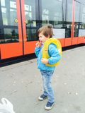 Boy waiting the tram Royalty Free Stock Image