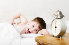 Boy waking up Stock Images