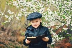 Boy on a walk in the garden in the spring stock photos