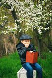 Boy on a walk in the garden in the spring stock photography