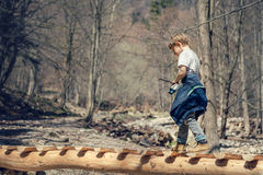 Boy walk in spring forest Stock Images