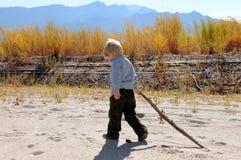 Boy walking along river royalty free stock photography