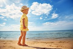 Free Boy Walking At Sea In Straw Hat Royalty Free Stock Photography - 113819907