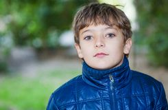 Boy walking in autumn time Stock Images