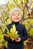 Boy walking in autumnal park Royalty Free Stock Photos
