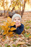Boy walking in autumnal park Royalty Free Stock Photography