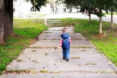 Boy walking away Stock Photo