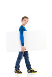 Boy walking with banner. Royalty Free Stock Images