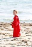 Boy walking by beach Stock Photo