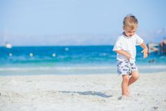 Boy with walking on beach stock photo