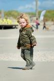 Boy walking on the beach Stock Photography