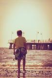 Boy walking on beach. Royalty Free Stock Photos