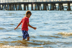 Boy walking on beach. Stock Photo