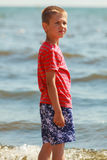 Boy walking on beach. Stock Images