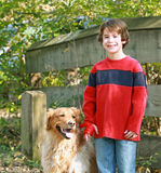 Boy Walking the Dog Stock Images